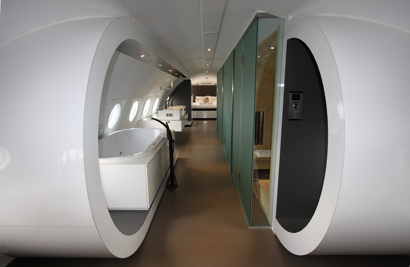Bathroom and in the back of the airplane the kingsize bed